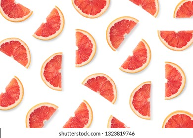 Fruit pattern of grapefruit slices isolated on white background. Top view. Flat lay