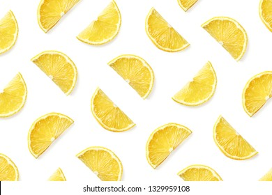 Fruit pattern of lemon slices isolated on white background. Top view. Flat lay