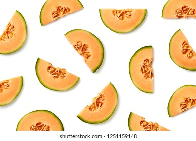 Fruit pattern of melon slices isolated on white background. Top view. Flat lay