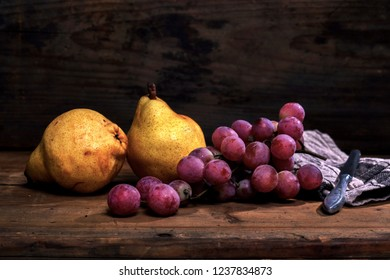 fruit, pears and grapes on wooden background