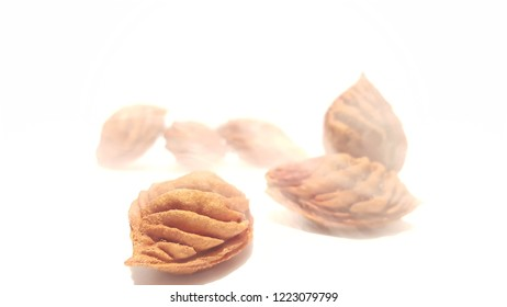 Fruit Pits on White Background.  Nectarine Peach Seeds With Misty/Foggy Effect.