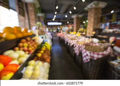 A lot of fruit is placed on the shelves of the supermarket