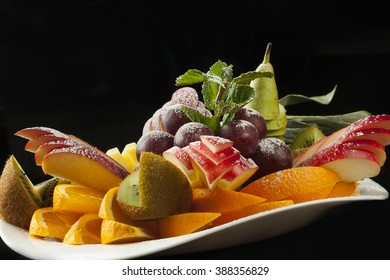 fruit plate on a black background