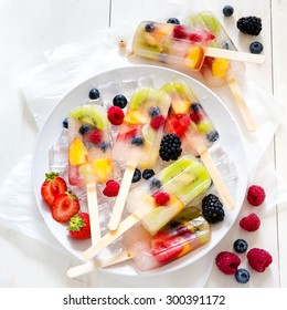 Fruit Popsicles with Berries Kiwi and Peaches