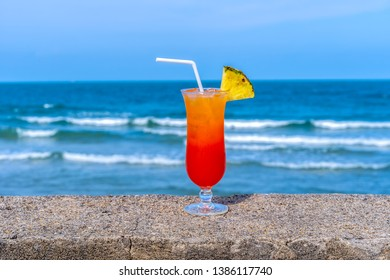 Fruit punch on the beach, refreshing fruit punch mocktail and summer drinks