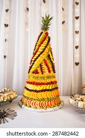 Fruit pyramid decoration at dessert table at party in restaurant