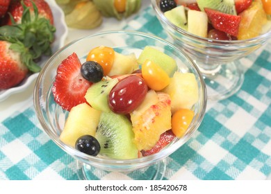 Fruit salad in a bowl on checkered napkin