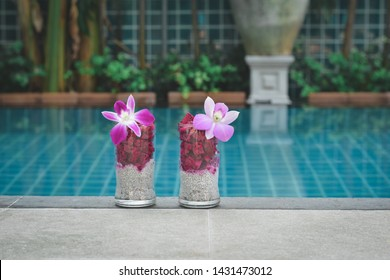 Fruit salad and chia puding on he tale by pool. Dragon fruit. Thai fruits and chia pudding. Fruit coctails