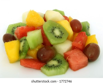 Fruit salad cocktail on a plate, macro close up isolated on white, with copy space
