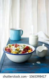 Fruit salad with coconut cream. Bright healthy breakfast