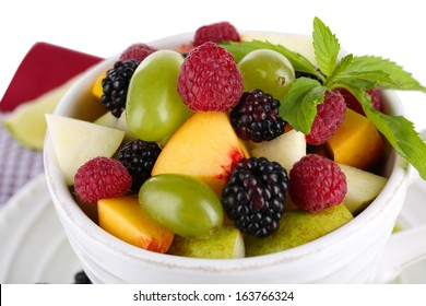 Fruit salad in cup on napkin isolated on white