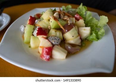 Fruit salad is a delicious dessert. Delicious fruit salad without fear of fat. Red apples, peaches, kiwi, strawberries, avocados, seedless grapes, mango, cherries, blueberries.