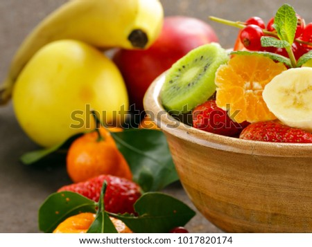 fruit salad for dessert and breakfast in a wooden bowl