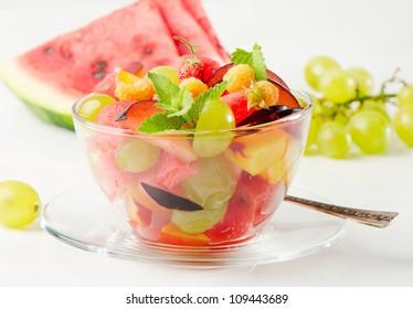 Fruit salad and fresh berries
