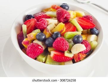 Fruit Salad with fresh berries. Healthy breakfast.
