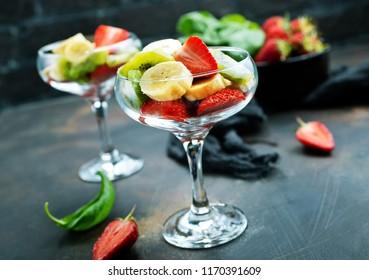 fruit salad in glass, fresh fruits, diet food