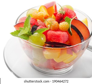 Fruit salad isolated on white background. Selective focus