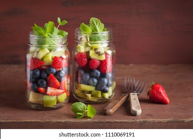 fruit salad in mason jar strawberry blueberry kiwi apple mint