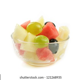 Fruit salad with melon, grape and watermelon, isolated on white