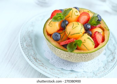 Fruit salad with melon, strawberry and blueberry