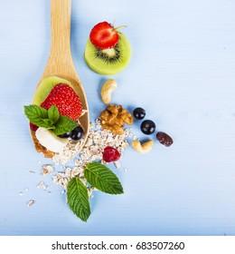 fruit salad on a wooden spoon - Shutterstock ID 683507260