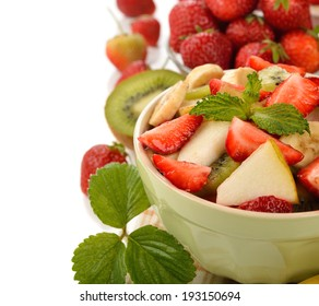 Fruit salad with strawberries on a white background