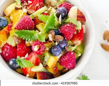 Fruit salad for sweet healthy breakfast. Top view