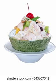Fruit salad in white ceramic bowl isolate background