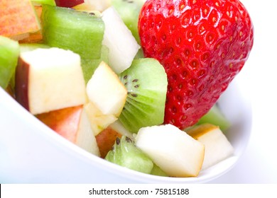 Fruit salad in white plate, closeup