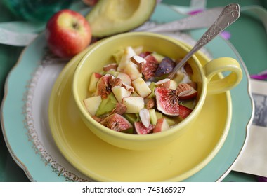Fruit salad in yellow cup