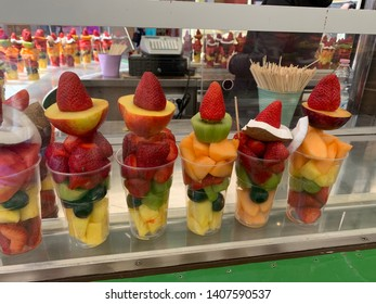 The fruit salat prepared in plastic cup on the market