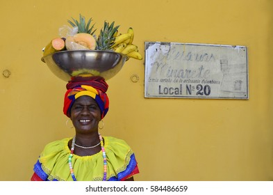 Fruit Seller in Caribbean Attire in Cartagena de Indias - February 2017 - Cartagena, Colombia
