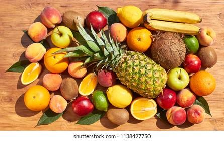 Fruit set from pineapple, oranges, lemons, peaches, nectarines, kiwi, bananas. Vitamins.