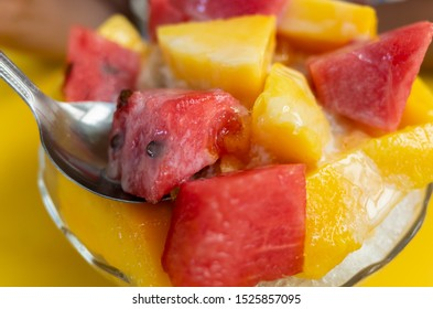 fruit shaved ice with watermelon and mango on a plate
