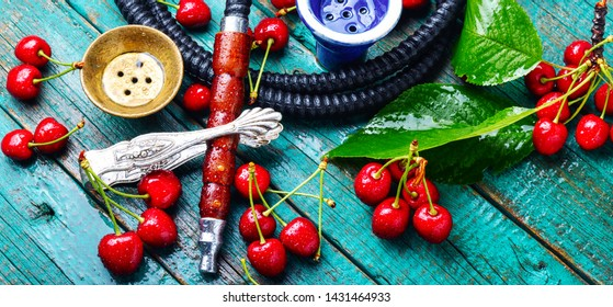 Fruit shisha.Eastern smoking nargile with cherry flavor.Hookah tobacco with cherry flavor