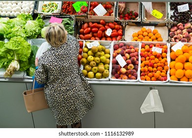 fruit shop in supermarket and woman buying