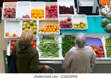 fruit shop in supermarket and women buying
