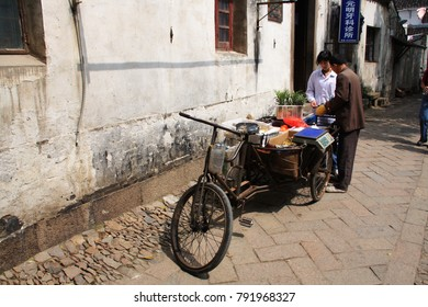 Fruit shop with tricycle in Suzhou Old town, Travel  in Suzhou City, China in 2009 , April 17th.