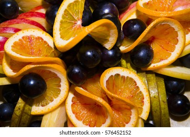 Fruit sliced and beautifully served on a platter. A fruit plate.