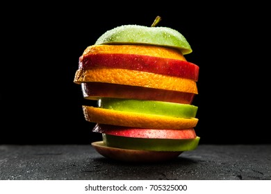 Fruit slices on black background