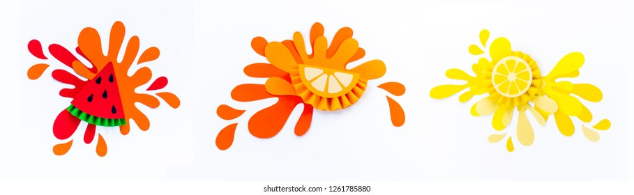 Fruit with splashes made of paper. White background. Fruit smoothies are vegetarian. Creating creativity with children. Slice of watermelon orange and lemon.