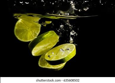 fruit splashing in the water,black background.
