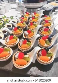 Fruit tart in bite size, sweet dessert buffet after meal, selective focus