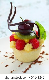 fruit tart with many fresh fruit, styling with cocoa.