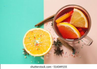 fruit tea or mulled wine in the glass with spices