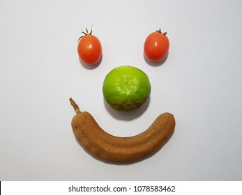 fruit and vegetable arr arranged to be a happy face