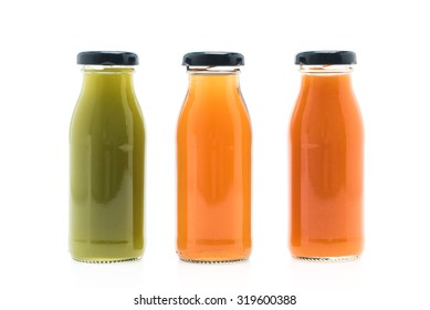 Fruit and vegetable juice bottles isolated on white background
