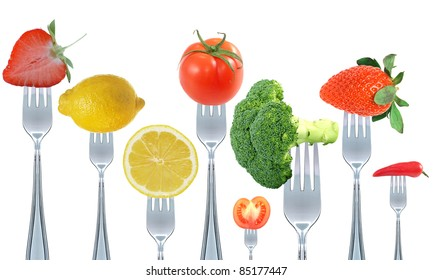 fruit and vegetable on fork isolated on white