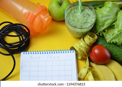 fruit and vegetable smoothie,juice. diet vegetarian is a healthy low-calorie food. notebook with a diet plan