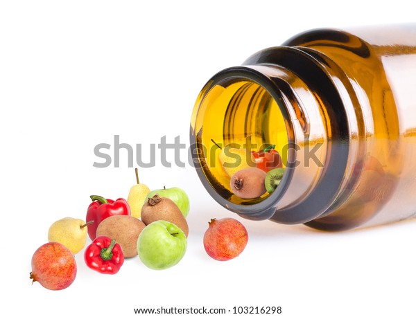 a fruit and vegetables in bottle like vitamins, on white, macro